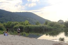 Fisherman at the river on the beach in Obzor, Bulgaria Stock Photos