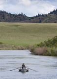 Fisherman on the River from Behind Stock Photography