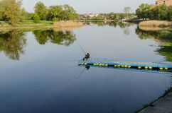 A fisherman at the river Stock Images
