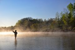 Fisherman in river - fly fishing royalty free stock images