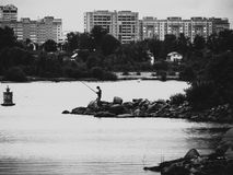 Fisherman. Fisherman on the river. The old filter Royalty Free Stock Photography