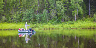 A fisherman on the river Stock Photos