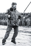 A fisherman on the river in winter Royalty Free Stock Photos