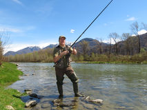 Fisherman on river Stock Photography