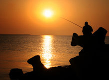 Fisherman with the Rod Royalty Free Stock Photos