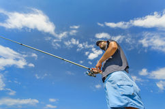 Fisherman roll casts a fly Royalty Free Stock Photography