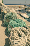 Fisherman ropes to tie and do knots on a harbor Stock Photography