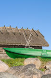 Fisherman rowboat and old rustic utility house Stock Photos