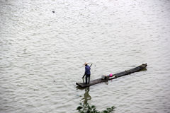 The fisherman is Rowing bamboo raft Royalty Free Stock Images