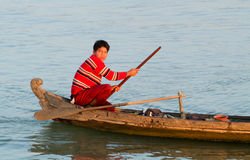 Fisherman rowing on his canoe at the river Ayeyarwady on Myanmar Stock Photos