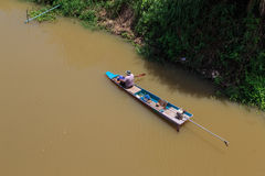 Fisherman rowing row boat to catch fish on river Royalty Free Stock Image