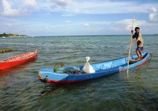 Fisherman rowing a sampan boat Stock Images