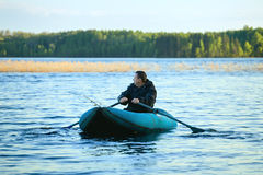 Fisherman in Rubber Boat Royalty Free Stock Photos