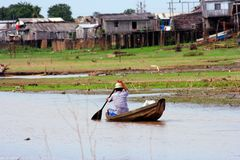Fisherman running. A canoe-Amazonia-Brazil Stock Photos