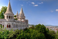 Fisherman's bastion Budapest. Fisherman's bastion of the castle on the hill of Buda, trees and skyline of Budapest, Hungary, in the sun stock photo