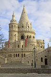 Fisherman's Bastion and Matthias Church in Budapest, Hungary. Fisherman's Bastion in Budapest, Hungary.  Fisherman's Bastion is a terrace in neogothic style. It Stock Photo