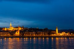 Fisherman`s bastion in night lighting and its reflection in the Danube in Budapest, Hungary stock image