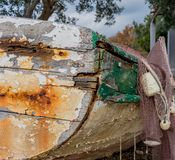 A fisherman`s boat abandoned with a fishing net stock images