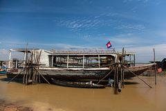 Fisherman`s boat and house. Tonle Sap lake, Siem Reap, Cambodia Stock Images