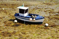 Fisherman's boat during low tide. Royalty Free Stock Photography