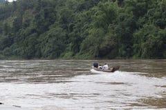 Fisherman`s boat navigating the Nam Ou River in northern Laos. Laos Royalty Free Stock Photo