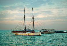 A fisherman`s boat off the coast of Zanzibar in the Indian Ocean. A fisherman`s boat floating off the coast of Zanzibar in the Indian Ocean, on a cloudy January Royalty Free Stock Photography