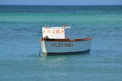 Fisherman`s Boat off Palm Beach In Aruba Stock Photos