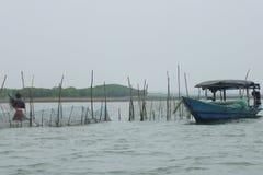 Fisherman & his boat stock photo