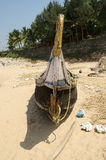 Fisherman`s boat on the sand beach. Kerala, South India Stock Photos