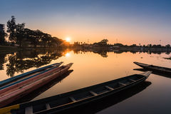 Fisherman's Boats docked with sunshine reflection Royalty Free Stock Photography