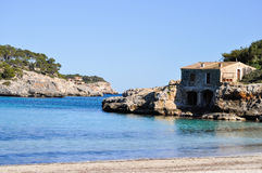 Fisherman's cottage by the sea. In a bay of Mallorca Stock Photo
