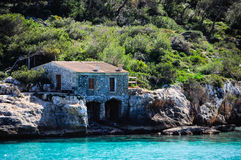 Fisherman's cottage by the sea. In a bay of Mallorca Royalty Free Stock Photography