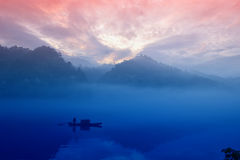 The fisherman's dawn silhouettes Stock Images
