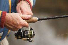 Fisherman`s hands with spinning. Stock Photo