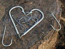 Fisherman's heart. Fishing hooks in the form like a heart Stock Images