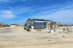 Fisherman`s house on the beach stock photos