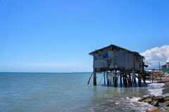 Fisherman's house on the edge of the blue sea. Philippines. Royalty Free Stock Photos