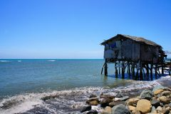 Fisherman's house on the edge of the blue sea. Philippines. Stock Photo