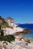 Fisherman's house at the rocky stone beach in island Susak,Croatia Royalty Free Stock Images