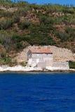 Fisherman's house at the rocky stone beach in island Susak,Croatia Stock Photo