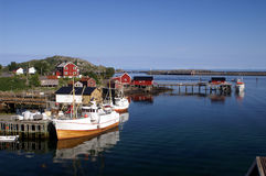 Fisherman's houses on Lofoten. Fisherman's cabins and boats in a fjord at Lofoten islands, Norway Stock Photos
