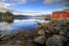Fisherman's hut, fjord scenic Royalty Free Stock Photo