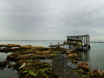 Fisherman's hut in still waters Royalty Free Stock Image