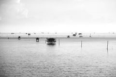 Fisherman`s huts in the blue sea, black and white style Stock Image