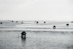 Fisherman`s huts in the blue sea Royalty Free Stock Images