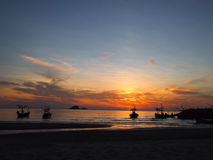 Fisherman's life. Silhouette seashore with fishing boats Stock Photo