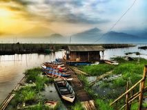 Fisherman's morning activity in the swampy village. Morning activity of fisherman in the lake Stock Photo