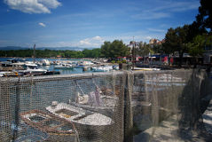 Fisherman's net in Njivice harbour with motor boats on island Krk Stock Images