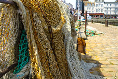 Fisherman's nets in old harbor in France stock photography