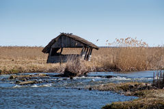 Fisherman's old hut by the river Royalty Free Stock Image